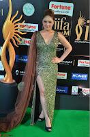 Nikesha Patel in Glittering Leg Split Deep Neck Green Gown at IIFA Utsavam Awards 2017     08.JPG