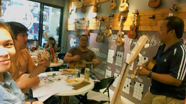 Learning to play the ukulele at UkeHUB Kafe in Mactan Island Lapulapu City Cebu Philippines