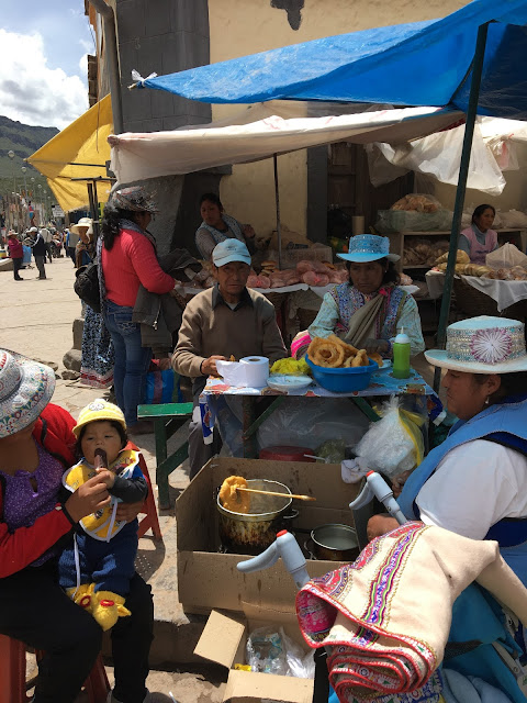 selling picarones at the Chivay market, Peru