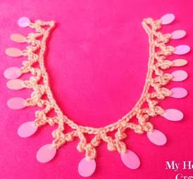http://translate.googleusercontent.com/translate_c?depth=1&hl=es&rurl=translate.google.es&sl=en&tl=es&u=http://www.myhobbyiscrochet.com/2013/10/sequined-crochet-trim-necklace-oriental.html&usg=ALkJrhjySunF2MTtXK3dAxbDEKTFIS_3qw