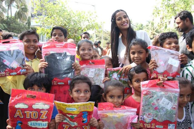 Poonam Pandey Distribute Raincoats to Street Children