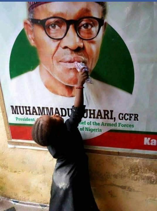 Viral photo of a girl feeding President Buhari