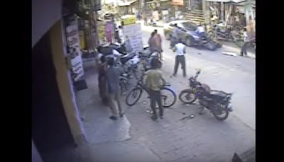 A black Honda city tried to to escape after an accident in Gurgaon carrying the victim on its bonnet.  A video of the incident, which occurred on March 28, shows the victim hanging on to the bonnet doggedly. The car reportedly drove for half-a-km endangering his life.  Zee News reports that Prateek Kumar and his three-year-old son, who was also in a car, was hit by the Honda City on Old Delhi road.