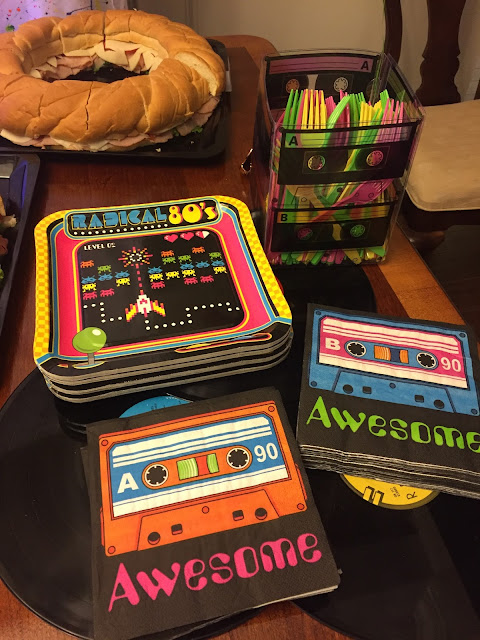 80's theme 30th birthday costume party. 80's style DIY outfit ideas. 80's photo booth backdrop and props. 80's party decorations