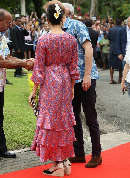 Meghan Markle wore CASTAÑER Carina canvas wedge espadrilles and Figue Frederica printed ruffle dress