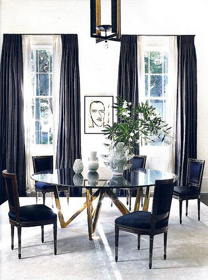 black chairs with brass table