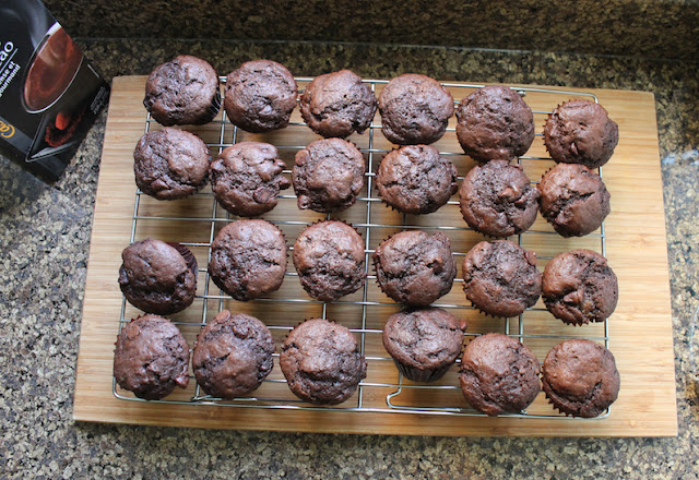 Food Lust People Love: These Chocolate Chocolate Chip Mini Muffins are made from rich chocolate batter with lots of extra chocolate chips. But because they are mini sized, they are perfect as a party snack or buffet table dessert.