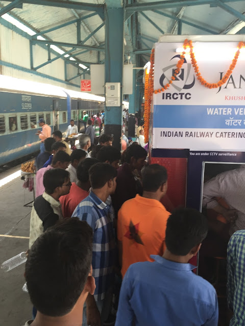Public Swarming after the arrival of train to JanaJal Water ATM @ Igatpuri Station in Mumbai-