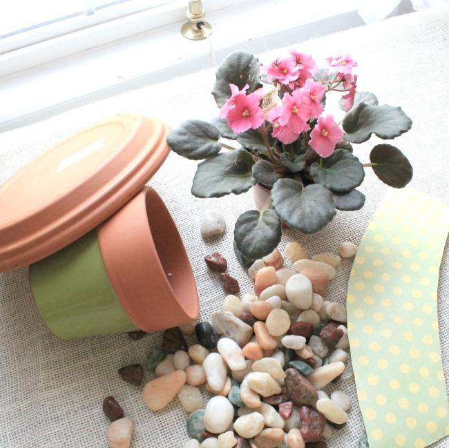 Clay pots used to make birdbath plant holder.