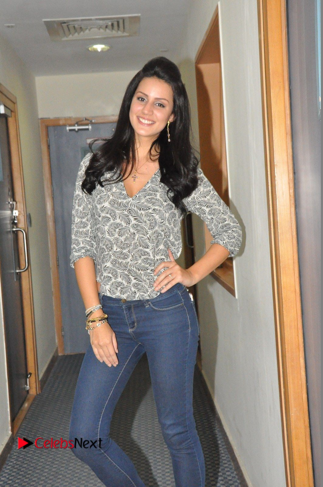 Actress Larissa Bonesi Pictures in Jeans at Big FM For Thikka Movie Promotions  0014.JPG