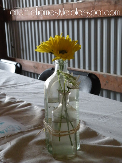 Vintage bottle and wildflower wedding centerpieces