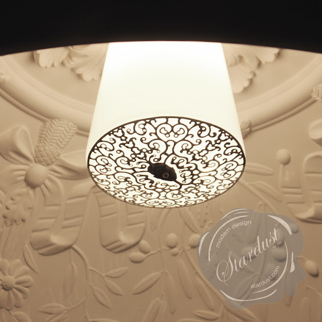 A close-up look of the Flos Skygarden Pendant Lamp when looking up.  This picture was taken at night with no other lights in the room; the only light being supplied by the Skygarden Chandelier.  Please note the detailed inner lamp diffuser with the logo designed by Marcel Wanders.  All Flos Lamps are available in the US through modern design purveyor Stardust with a 110% Low Price Match Guarantee and Free Shipping.