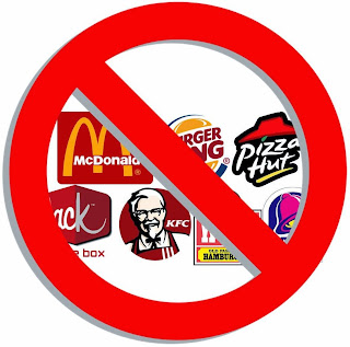 Fast food corporations with a restriction sign