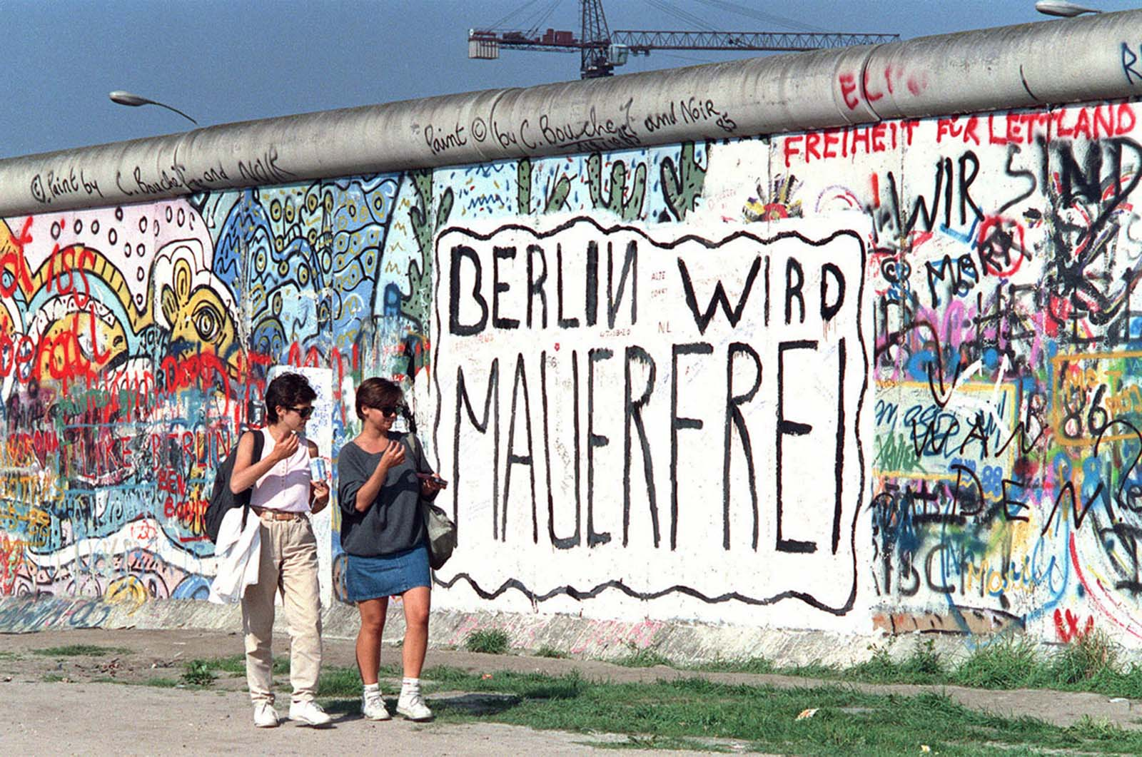 In this photo taken on August 11, 1988, the year before the Berlin Wall came down, a message is seen painted on the wall at Potsdamer Platz: