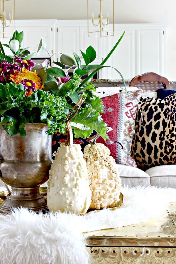 fall decor, fresh flowers, vintage silver trophy urn, silver champagne bucket, white pumpkins, faux fur, kilim pillow, leopard pillow