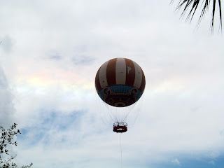 Rainbow in the sky behind the balloon at Disney Springs