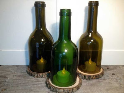 Bonitos porta velas con botellas de vino.