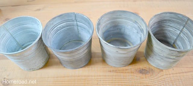 4 pails with different patinas