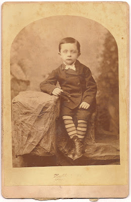 Tully family Hull artist Chicago striped socks young boy seated