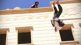 "Islamic State militants ""execute"" two men for homosexuality by throwing them off a building roof in Homs, Syria, in August 2015."