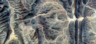 the Mummy,abstract landscapes of deserts of Africa stone face,abstract photography deserts of Africa from the air,abstract surrealism,mirage in desert,fantasy of stone,abstract expressionism
