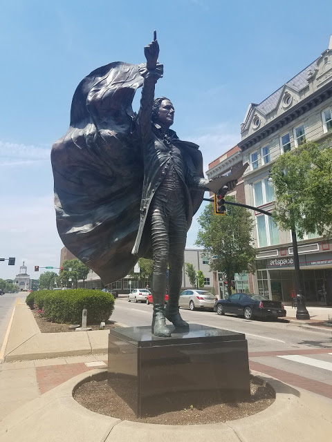 Alexander Hamilton statue in Hamilton OH, american flag, outdoor art