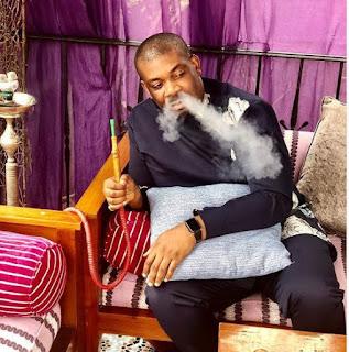 Don Jazzy smoking Shisa