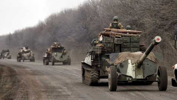 Ukraine began to withdraw heavy weapons from the war zone