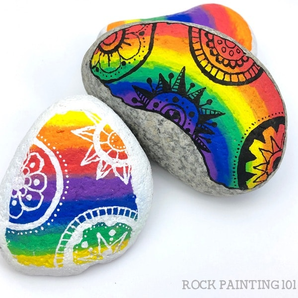 how to paint rocks with a rainbow background
