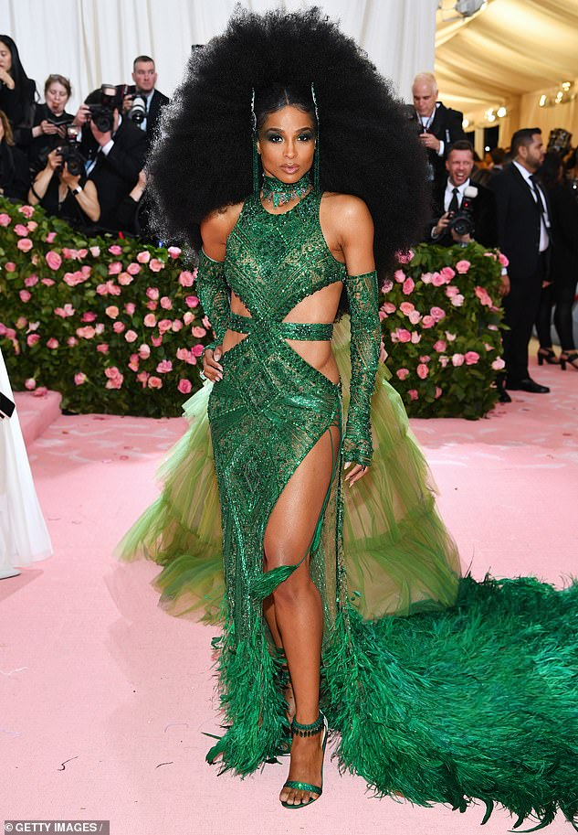 Ciara steps out at the Met Gala in emerald green cut-out gown complete with a large Afro wig