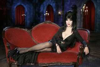 Elvira relaxing on loveseat