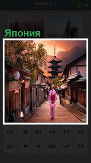 Пейзаж Японии, по тропинке идет женщине в направлении к пагоде