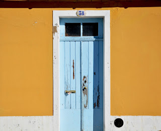 A light blue wooden door