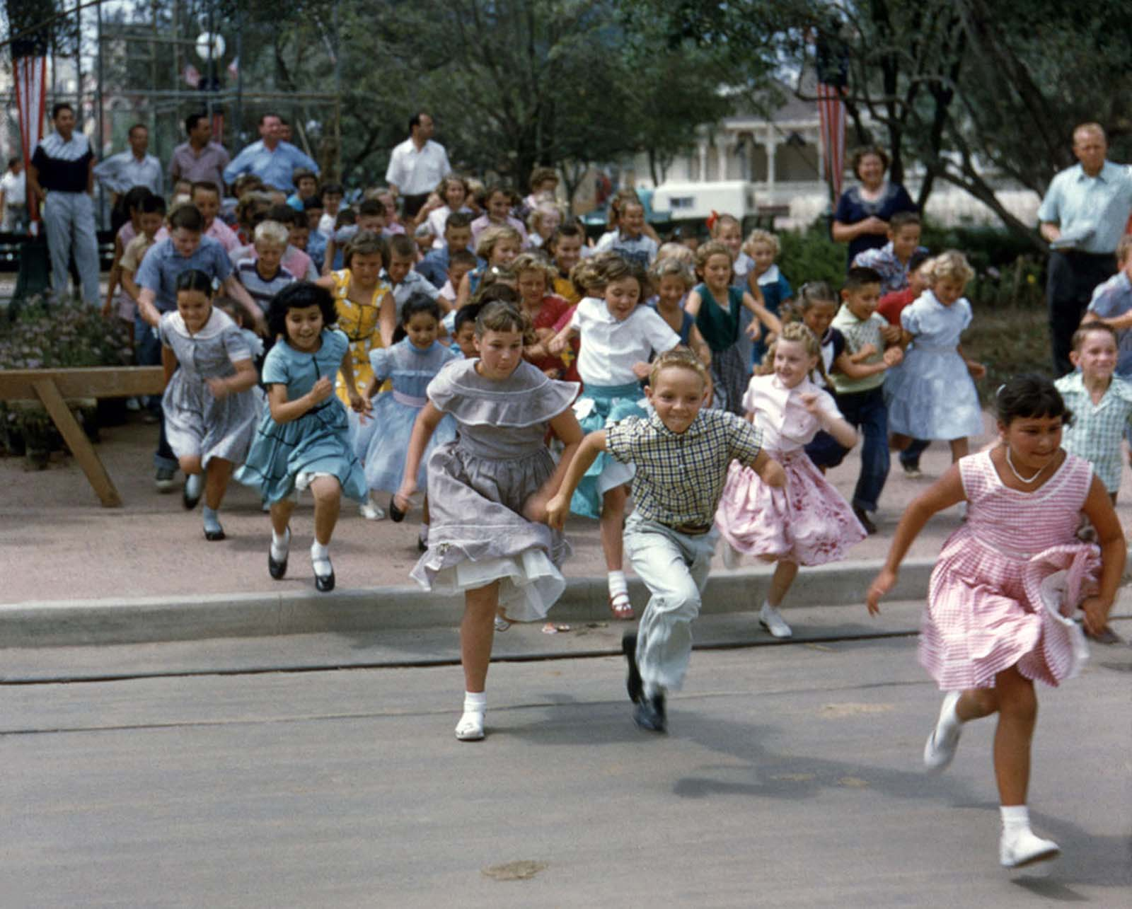 Children run into Disneyland on opening day, July 17, 1955.