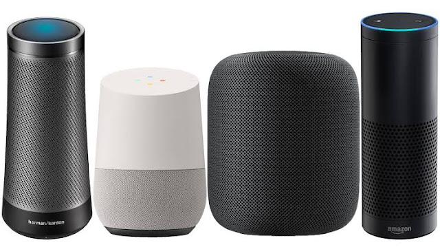 An Array of Smart Speakers showing the Harman Kardon Invoke, Google Home, Apple Homepod and Amazon Echo (From left to right)