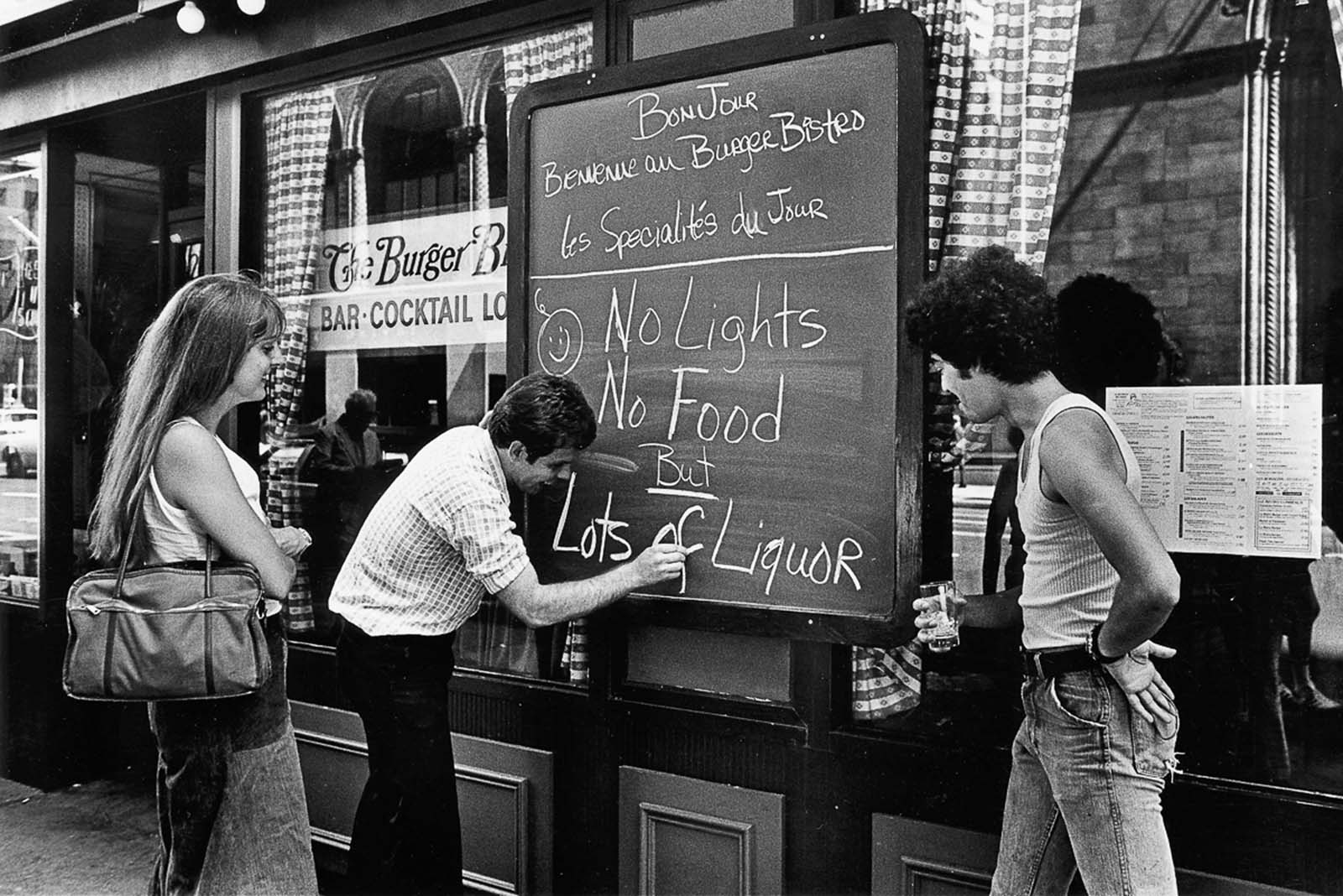 A restaurant owner updates the specials of the day during the blackout.