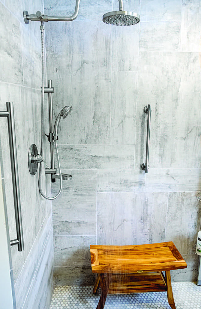 Grab bars, non-skid floors, and bright lighting help a shower or bathroom allow for aging in place.