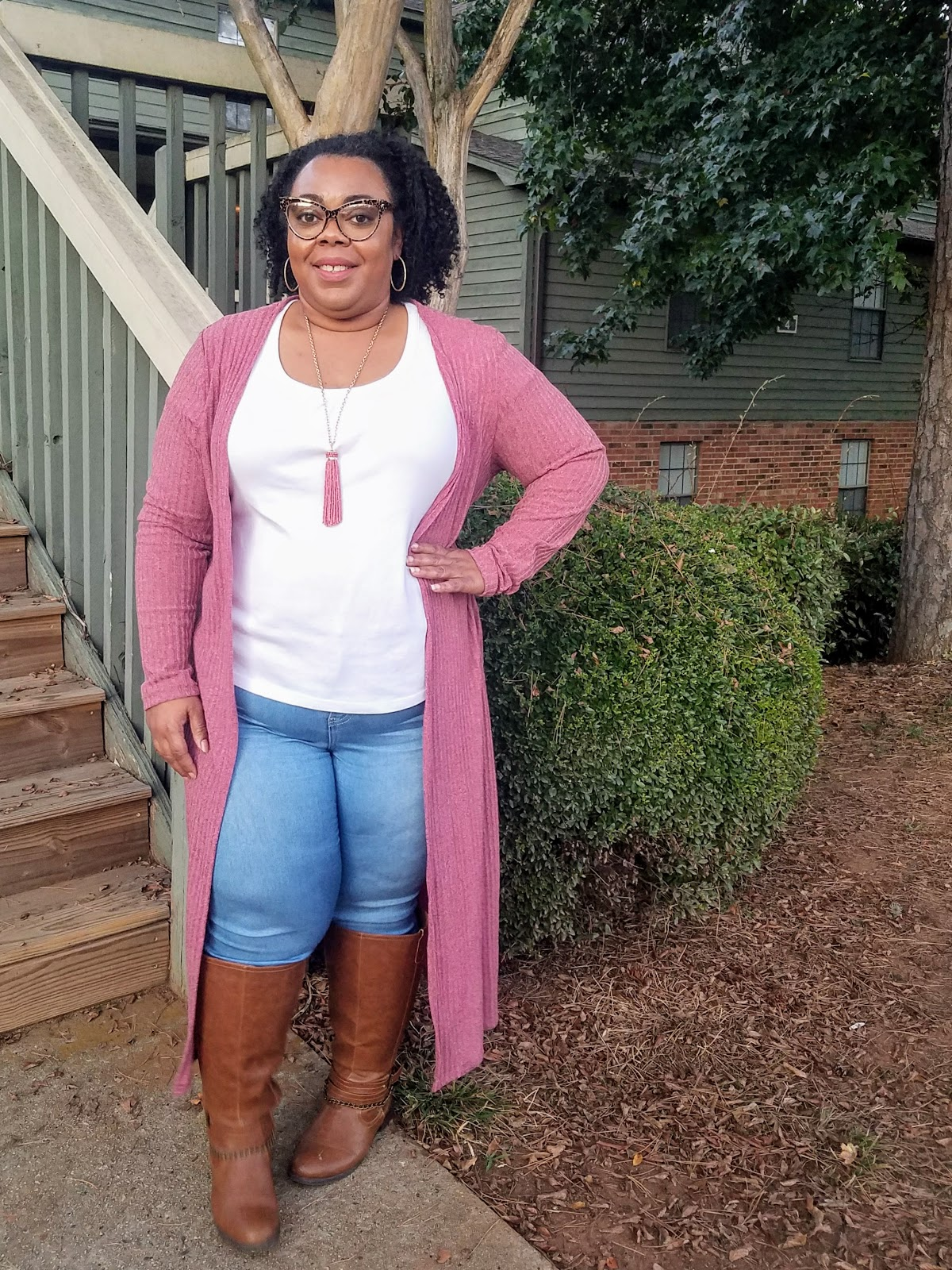 mauve duster, skinny jeans, tall boots, tassel necklace, natural hair, protective style, natural make up