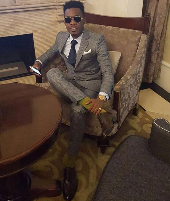 Patoranking is looking like a bag of money in suit after arrest in Uganda