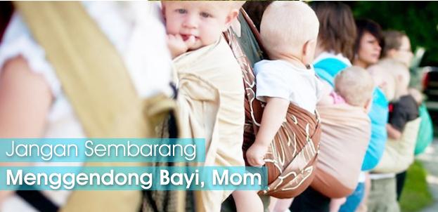 Menggendong Bayi