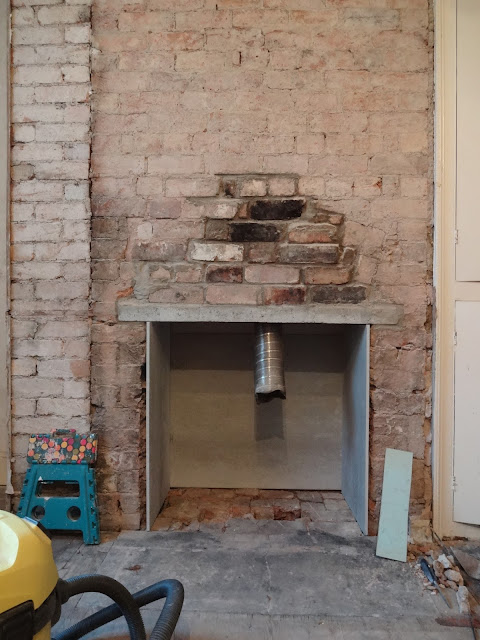 fitting fireproof board in a chimney opening