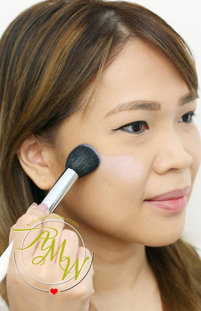 a photo on how to apply Tony Moly Cheektone Powder review in shade P01