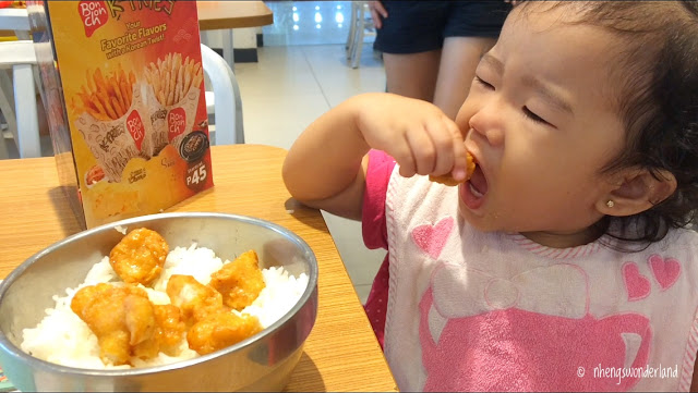 little-girl-eating-chicken-poppers