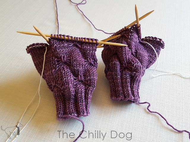 How to hold the stitches of a knit thumb gusset on a piece of waste yarn while knitting the hand of mittens or gloves