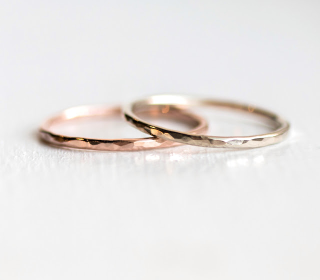 Thin hand hammered bands in 14k rose and yellow gold with bright polish finish