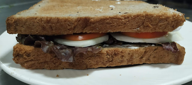 Two brown bread with vegetables inside for veg club sandwich recipe