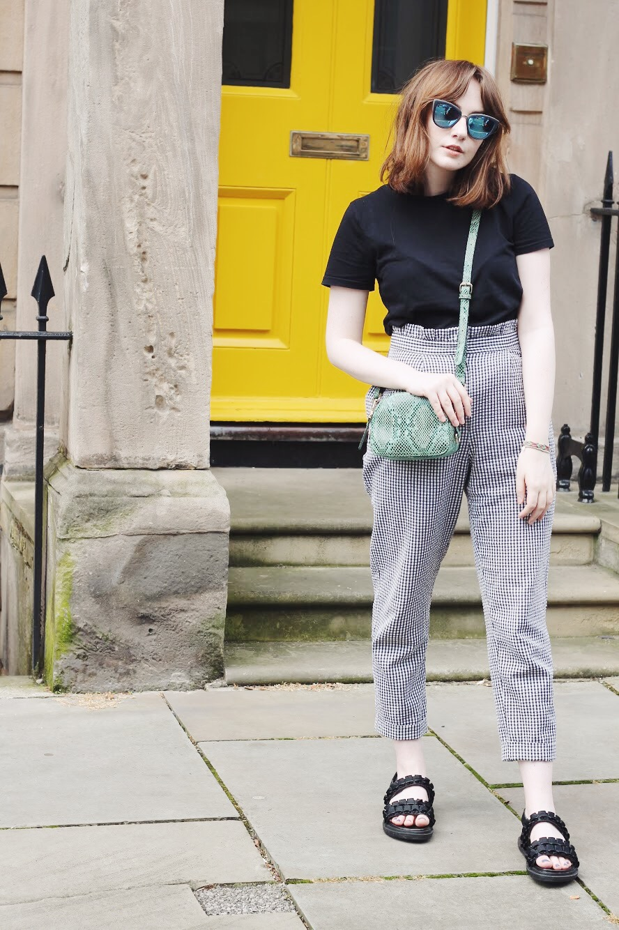 gingham ss17 outfit from liverpool fashion blogger featuring plain black t shirt, black and white gingham trousers, green snake print cross body bag and black sandals