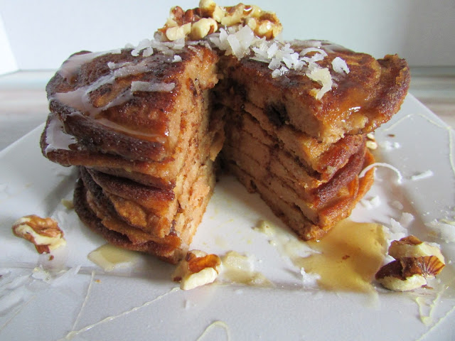 Stack of pumpkin pancakes on a plate with a bite missing