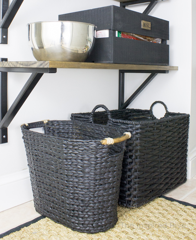 DIY industrial farmhouse pantry. Great idea to update baskets with spray paint and use them to store kitchen towels and bibs!