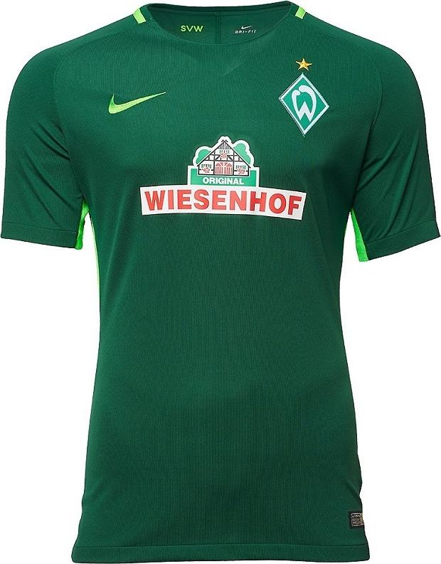 383e2f26d0 A camisa reserva é predominantemente branca com finas listras horizontais  em verde e detalhes mais claros na gola e nas laterais.